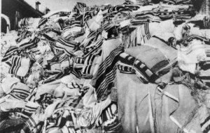 A large pile of Jewish prayer shawls (tallesim, tallitot) confiscated from arriving prisoners and stored in one of the warehouses in Auschwitz. (from Lydia Chagoll Collection)